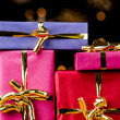 Four Single-Colored Gifts with Golden Bows — Stock Photo
