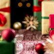 Christmas Gifts Placed on a Festive Cloth — Stock Photo #51244985