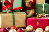Xmas Gifts in Red, Green and Gold — Stock Photo