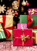 Christmas Background with Gifts and Glitters — Stock Photo