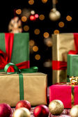 Xmas Presents Between Baubles and Twinkles — Stock Photo