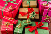 Wrapped Gifts Assorted by Color — Stock Photo