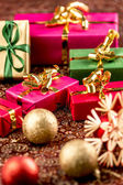 Little Christmas Gifts in Festive Setting — Stock Photo