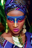 Beautiful black woman with color makeup with gold  ornamentation — Stock Photo