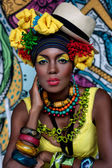 Portrait of an African girl on the background of the painting — Stock Photo
