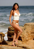Beige Knit Beachwear - Ocean Wave and Rock Background  - Well-Tanned Brazilian Professional Model — Stock Photo