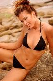 Two Piece String Bikini - Black - Professional Brunette Model -Tan Rock Background — Stock Photo