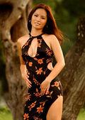 Black Dress - Red Flowers - Aborable Asian Brunette — Stock Photo