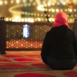 Muslim woman praying in a mosque — Stock Photo #49486479