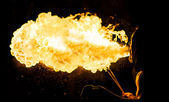 Fire eater from behind — Stock Photo