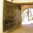 The gate to the castle fortification iron paneled — Stock Photo #50413477