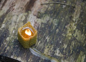 Burning beeswax candle — Stock fotografie