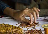 Burmese sewed beads: close up — Stock Photo