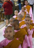 Girl monk in a row — Stock Photo