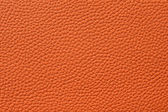 Closeup of seamless orange leather texture — Stock Photo