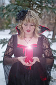 Witch with candle — Stok fotoğraf