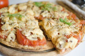 Pizza with mushrooms and tomatoes — Stock Photo