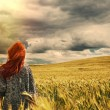 Fashion young red hair woman standing back outdoor on breathtaki — Stock Photo #49786349