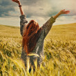 Young red hair woman standing back hands up to breathtaking view — Stock Photo