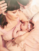 Caring loving parents holding cute sleeping little baby girl wit — Stock Photo