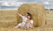 Embracing couple admire beautiful nature in summer — Stock Photo