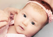 Little baby girl with pink flower headband exploring the world w — Stock Photo