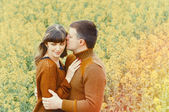 Attractive sensual couple in love outdoor into the depth of beau — Stock Photo