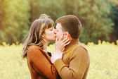 Happy sensual couple kissing in love outdoor into the depth of b — Stock Photo