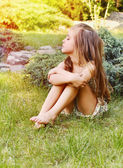 Young little naughty girl outdoor in the park — Stock Photo