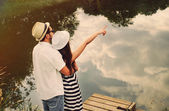 Embrace of happy romantic couple explore the world of beautiful  — Foto Stock