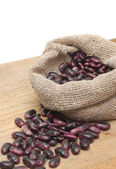 Purple beans in burlap sack — Stock Photo
