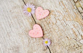 Two little pink hearts on wooden background — Foto de Stock