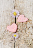 Two pink hearts on wooden background — Foto de Stock