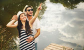 Embrace of happy romantic couple on pier explore the world of be — Stock Photo