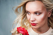 Sensual tender young woman portrait with breeze hair and red lip — Stock Photo