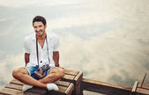 Handsome young stylish men with vintage camera chill out by the  — Stock Photo