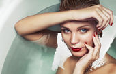 Portrait of a beautiful glamourous blonde in water, beauty spa c — Stock Photo