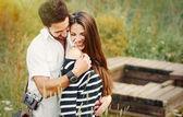 Happy romantic couple in love and having fun with daisy, beauty  — Stock Photo