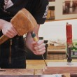 Carpenter working with wooden mallet and wood chisel — Stock Photo #49951025