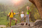 Father and two children with backpacks on beautiful nature — Stock Photo