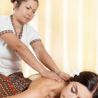 Young woman getting massage in Thai spa. — Stock Photo #50910231