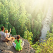 Family of backpackers look at beautiful view — Stock Photo #50910299