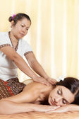 Young woman getting massage in Thai spa. — Stock Photo