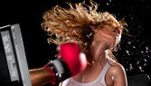 Virtual boxer beats the girl's face from computer — Stock Photo