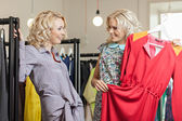Women in the clothes shop — Stock Photo