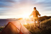 Backpacker in a camp — Stock Photo