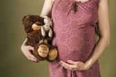Pregnant with the toys — Stock Photo
