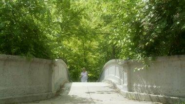 Blonde Crossing Bridge — Stock Video