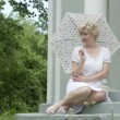 Seated Parasol Girl — Stock Video #50158949