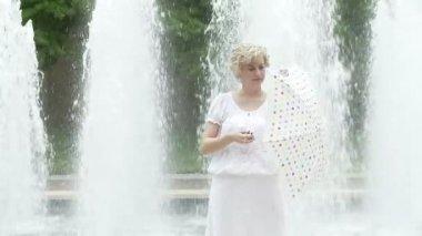 Umbrella and Fountain — Stock Video